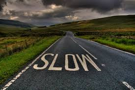 Slow-Down-You-Clown-Newby-Head-England-GB-road-deserted-field-country-street-cloud-grass-rolling-hills-left-hand-sign-road-quiet-travel-tourist-Europe